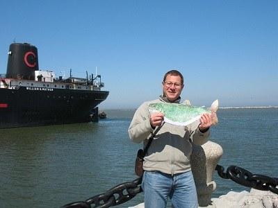 Lake trout entertaining tourist on lakeshore, Lake Erie, Cleveland