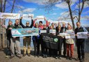 The staff at The Nature Conservancy in Maine proudly display their flat fish alongside the Androscoggin River!